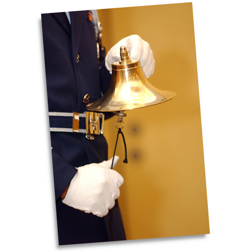 A member of the Offutt Air Force Base Honor Guard rings a bell