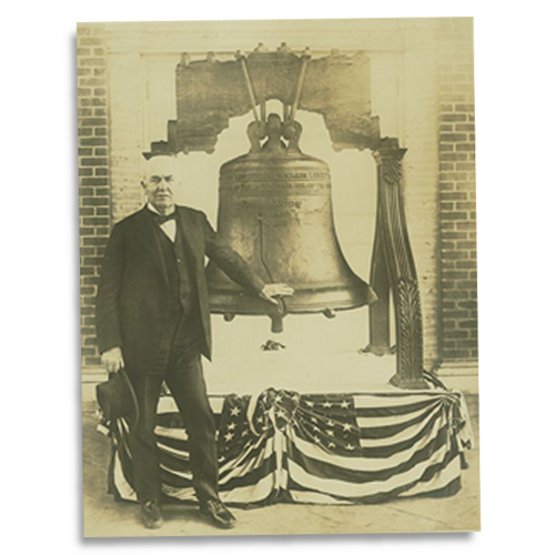Thomas Edison poses with the Liberty Bell in San Francisco