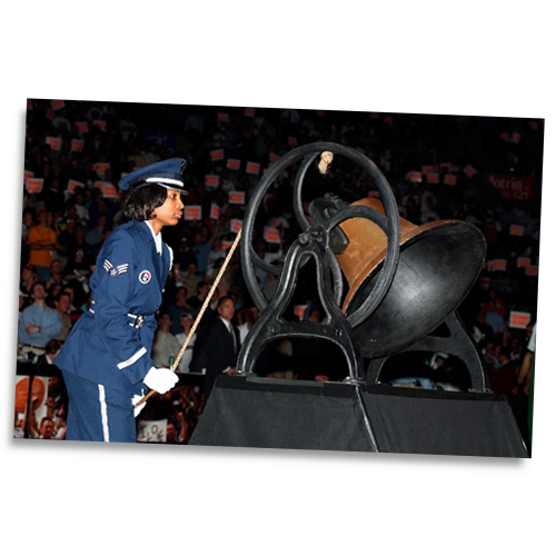 U.S. Air Force Senior Airman Nina Roulhac rings a replica Liberty Bell